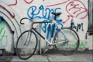 Bicycle at Graffiti on Wall , Amsterdam, Netherlands
