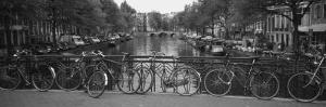Bicycle Leaning Against a Metal Railing on a Bridge, Amsterdam, Netherlands