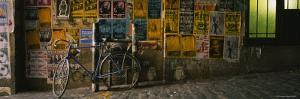 Bicycle Leaning Against a Wall with Posters in an Alley, Post Alley, Seattle, Washington, USA