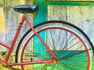 Bicycle Resting Against Colorful Barn Door