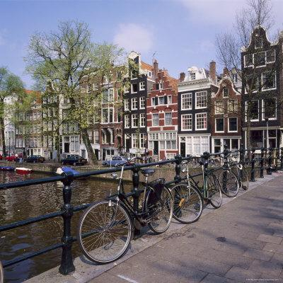 https://imgc.allpostersimages.com/img/posters/bicycles-on-a-bridge-across-the-canal-at-herengracht-in-amsterdam-holland_u-L-P2QWA10.jpg?p=0