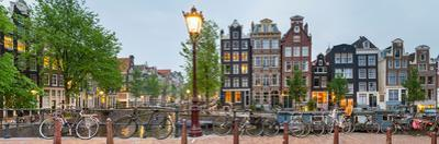 Bikes and Houses Along Canal at Dusk at Intersection of Herengracht and Brouwersgracht