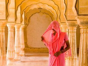 Arches with Hindu Woman at Amber Fort Temple, Rajasthan, Jaipur, India by Bill Bachmann