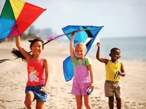 Children Flying Kites on the Beach by Bill Bachmann