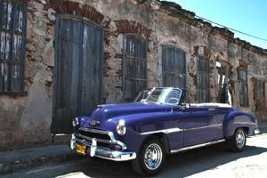 Classic 1953 Chevy Against Worn Stone Wall, Cojimar, Havana, Cuba by Bill Bachmann