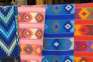 Colorful patterns and fabrics from San Antonio close to Lake Atitlan in Guatemala by Bill Bachmann