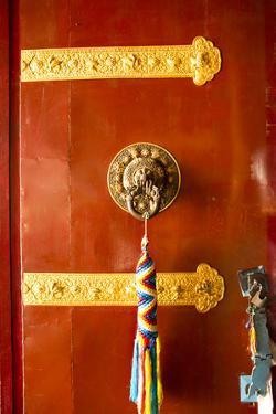 Door with Thong, Drikung Kagyu Richening Monastery. Kathmandu, Nepal by Bill Bachmann