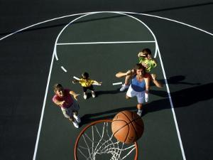 Family Playing Basketball Together by Bill Bachmann