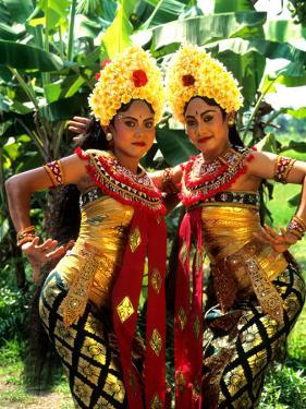Golden Dancers in Traditional Dress, Bali, Indonesia by Bill Bachmann