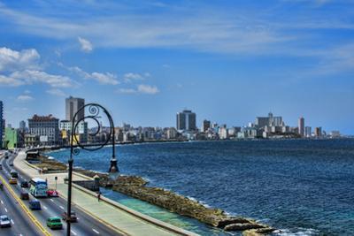 Havana, Cuba. Malecon along water by Bill Bachmann