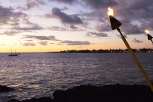 Kona, Hawaii, Big Island, Tiki Torch over Ocean at Kailua-Kona Beach by Bill Bachmann