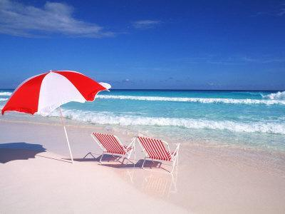 Lounge Chairs and Umbrella on the Beach