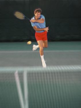 Man Hitting Tennis Ball by Bill Bachmann