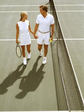 Middle-Aged Couple Relaxing after Tennis Match by Bill Bachmann