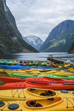Naeroyforden Fjord with Colorful Kayaks in Water, Gudvangen, Norway by Bill Bachmann