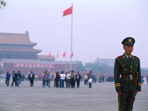 Policeman, Tiananmen Square, Beijing, China by Bill Bachmann