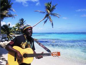 Reggae Singer with Guitar on Beach, Sainte Anne, Guadeloupe by Bill Bachmann