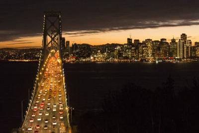 San Francisco, California, skyline and the Oakland Bay Bridge at evening. by Bill Bachmann