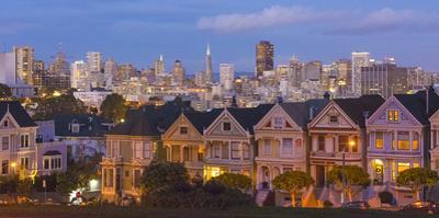 San Francisco, California, Victorian homes and city at dusk by Bill Bachmann
