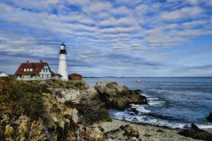 USA, Maine, Portland. Portland Headlight Lighthouse on Rocky Shore by Bill Bachmann
