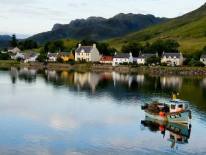 Village of Dornie with Reflections and Boat, Western Highlands, Scotland by Bill Bachmann