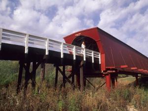 Woman on Roseman Bridge, Madison County, Iowa, USA by Bill Bachmann