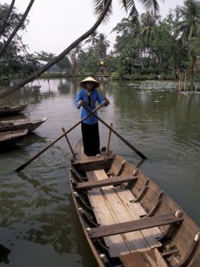 Woman Rowing, Mekong Delta, Vietnam by Bill Bachmann
