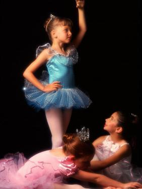 Young Ballerinas Wearing Tutus and Ballet Slippers by Bill Bachmann