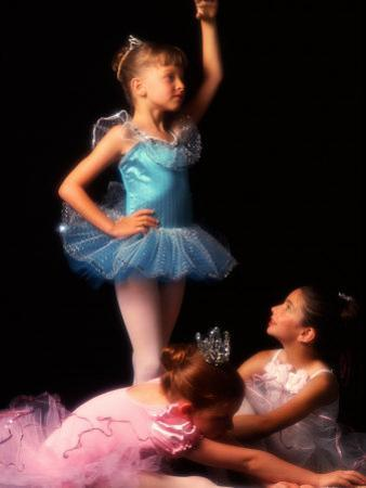 Young Ballerinas Wearing Tutus and Ballet Slippers