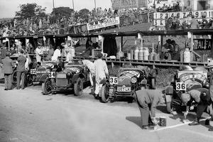 Alfa Romeos in the pits at the RAC TT Race, Ards Circuit, Belfast, 1929 by Bill Brunell