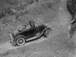 Kitty Brunell driving a 1930 2-seater Ford Model A, 1931 by Bill Brunell