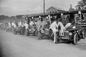 Triumph and Riley cars in the pits at the RAC TT Race, Ards Circuit, Belfast, 1929 by Bill Brunell