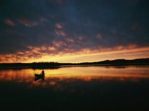 A Canoe at Sunset in East Manitoba by Bill Curtsinger
