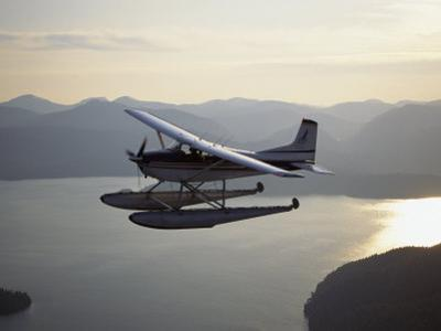 A Seaplane Takes a Sightseeing Tour over Misty Fjord by Bill Curtsinger