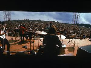 Huge Crowd Listening to a Band Onstage at the Woodstock Music and Art Festival by Bill Eppridge