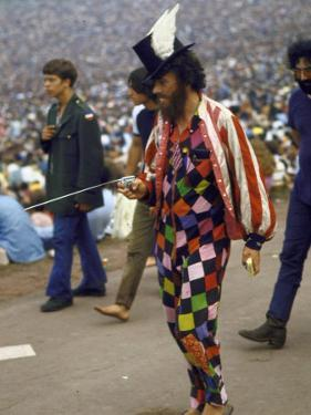 Paul Foster Walking During the Woodstock Music and Art Festival by Bill Eppridge