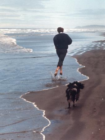 Presidential Candidate Bobby Kennedy and His Dog, Freckles, Running on Beach by Bill Eppridge