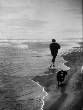 Robert F. Kennedy Running on the Beach with His Dog Freckles by Bill Eppridge