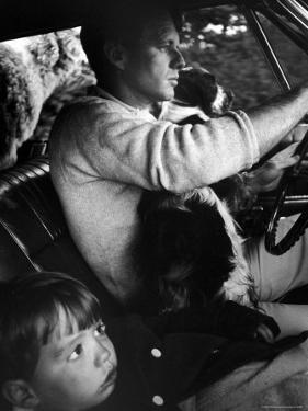 Sen. Robert Kennedy Driving His Car with Pet Springer Spaniel over His Lap and Son Max Beside Him by Bill Eppridge