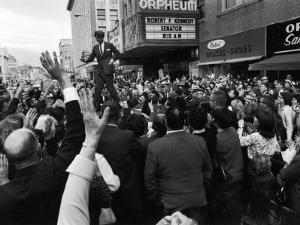 Sen. Robert Kennedy Standing on Roof of Car as He is Swamped by a Crowd of Welcoming Well Wishers by Bill Eppridge