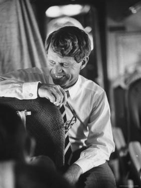 Senator Robert F. Kennedy Aboard Plane Traveling to Campaign For Local Democrats by Bill Eppridge