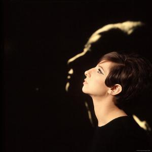 Singer and Actress Barbra Streisand in Front of Blow Up of Herself Also in Profile by Bill Eppridge