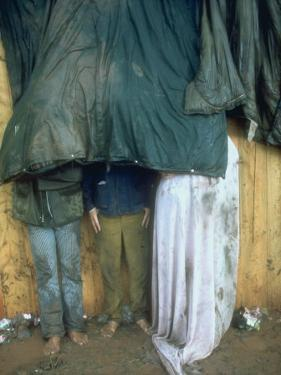 Taking Shelter from the Storm at Woodstock by Bill Eppridge