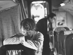 Thoughtful Senator Robert F. Kennedy on Airplane During Campaign Trip to Aid Local Candidates by Bill Eppridge