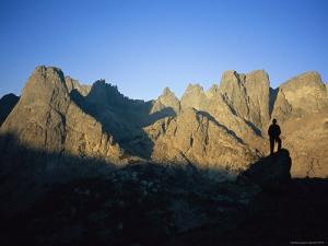 A Climber Silhouetted against Cirque of the Towers, Wind River Range by Bill Hatcher