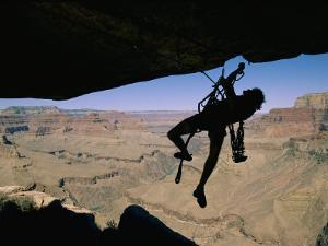A Climber Uses Aid to Scale an Overhang on the South Rim by Bill Hatcher
