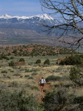 A Runner on the Hidden Valley Trail Above Moab, Utah by Bill Hatcher