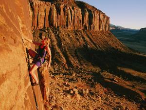 A Woman Rock-Climbing at Indian Creek by Bill Hatcher