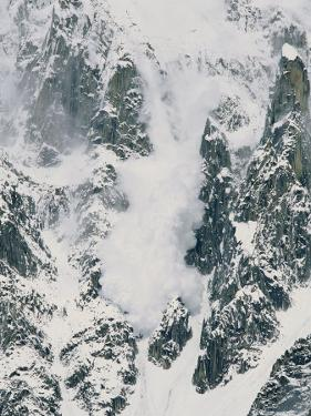 An Avalanche Thunders Down Nameless Tower in the Karakoram Range by Bill Hatcher