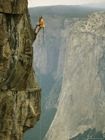 Climber Makes his Way up a Rock Face to Taft Point by Bill Hatcher